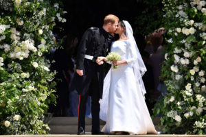 Meghan and Harry share a kiss outside the church
